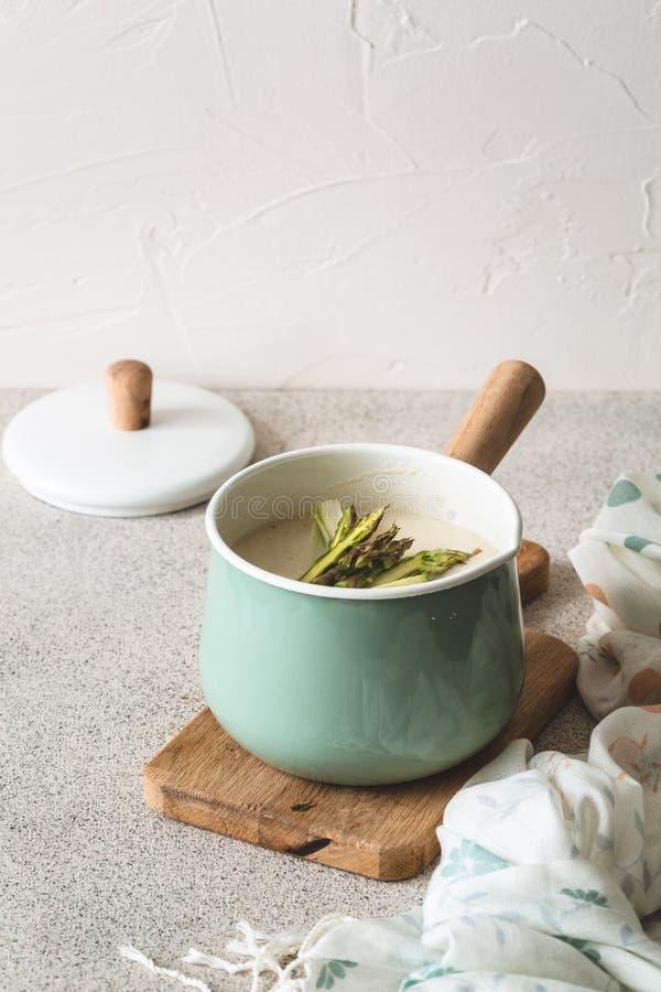 Delicious Asparagus Soup in Blue Casserole stock photos