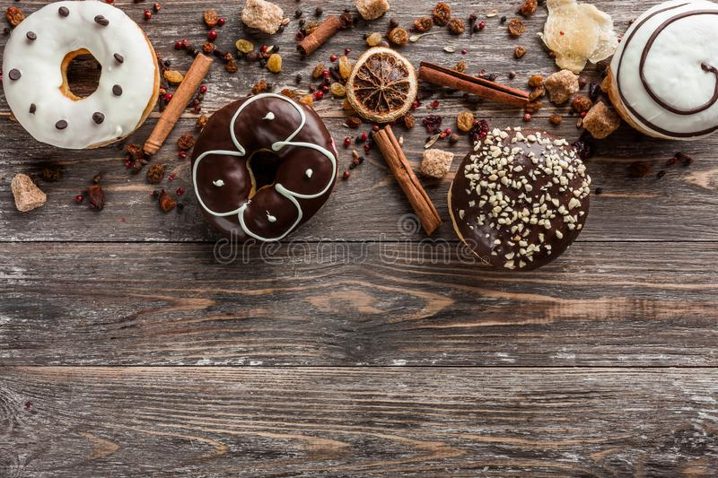 Delicious assorted donuts for a holiday. Top view and copy space, old wood background stock photography