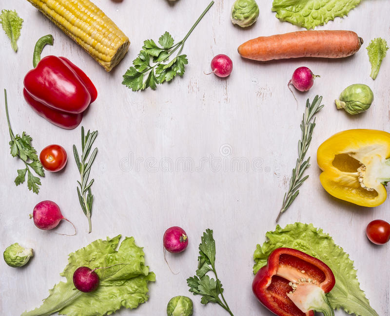 Delicious assortment of farm fresh vegetables lined frame on wooden rustic background top view close up place for text royalty free stock images