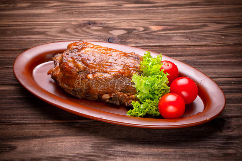 Delicious barbecued ribs seasoned with a spices and fresh herbs royalty free stock images