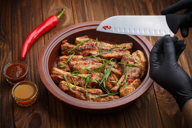 Delicious barbecued ribs seasoned with a spicy basting sauce stock photos