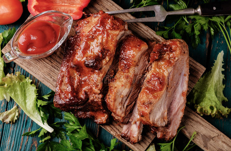 Delicious barbecued ribs seasoned with a spicy basting sauce stock images