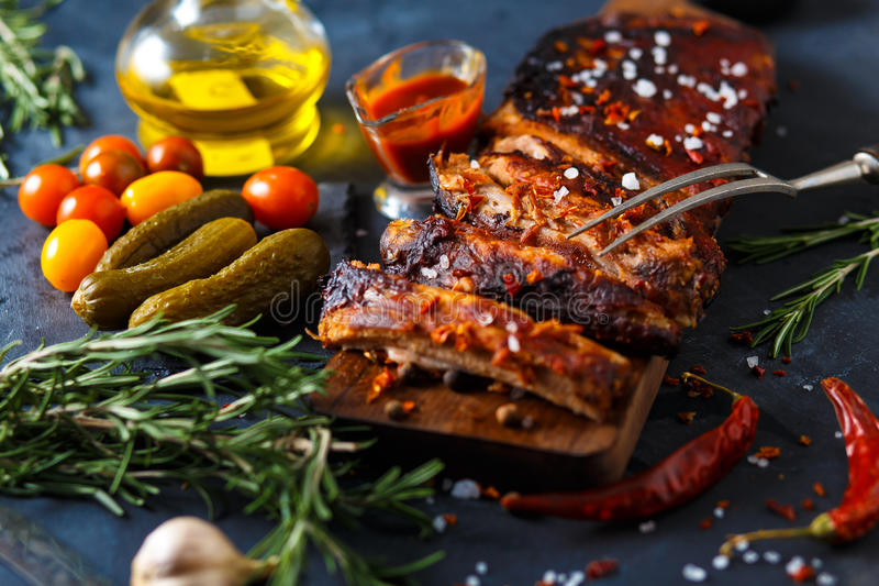Delicious barbecued ribs seasoned with a spicy basting sauce and served with chopped royalty free stock photography
