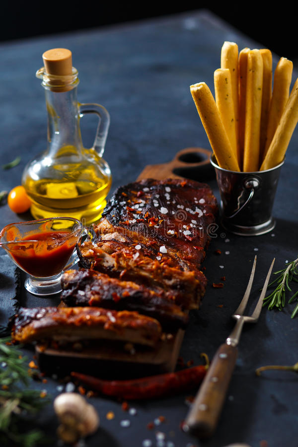 Delicious barbecued ribs seasoned with a spicy basting sauce and served with chopped stock image
