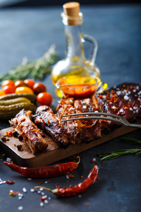 Delicious barbecued ribs seasoned with a spicy basting sauce and served with chopped royalty free stock photos