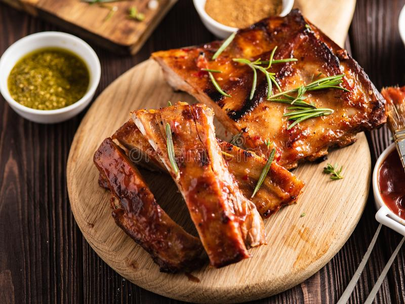 Delicious barbecued ribs seasoned with a spicy basting sauce and royalty free stock image