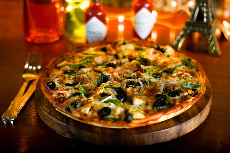 Delicious BBQ Chicken Cheese Pizza with extra cheese and Black Olive. Delicious & Spicy BBQ Chicken Cheese Pizza with extra cheese and Black Olive royalty free stock image