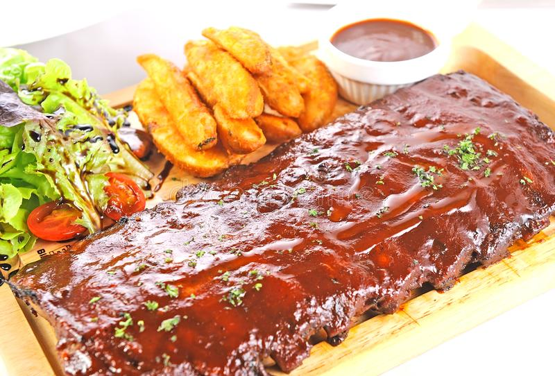 Delicious BBQ Ribs. And salad royalty free stock images