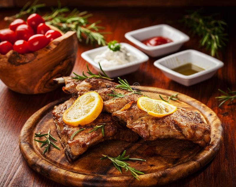 BBQ spare ribs with herbs. Delicious BBQ spare ribs with herbs royalty free stock photo
