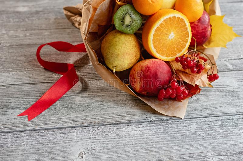A delicious and beautiful bouquet of fruits. Autumn wedding. The bride`s bouquet. Close up royalty free stock photos