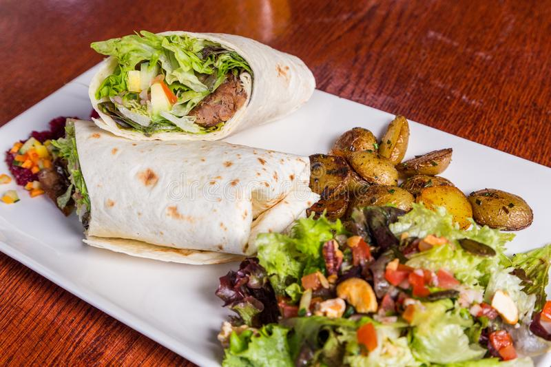 Delicious beef kabab with fresh salad and grilled garlic.  stock photo