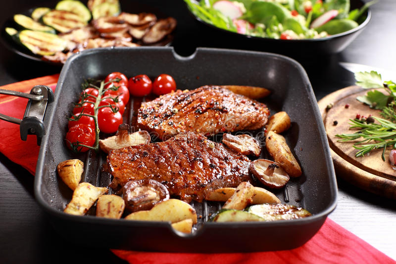 Delicious beef steak with grilled vegetable. And mushrooms royalty free stock photos