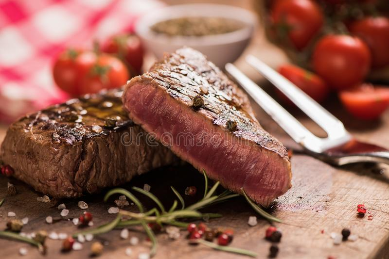 Delicious beef steak on wooden table royalty free stock photos