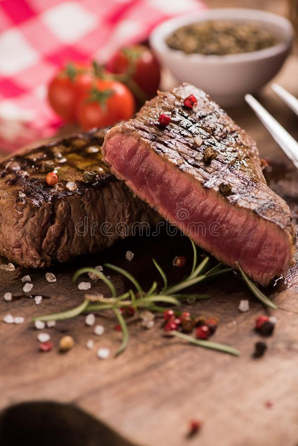 Delicious beef steak on wooden table stock image