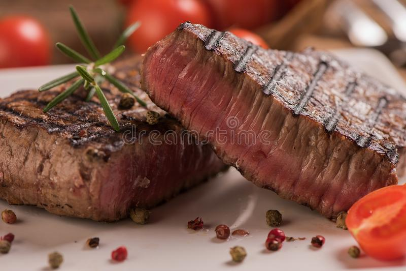 Delicious beef steak on wooden table royalty free stock images