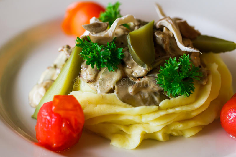 delicious beef stroganoff with cucumber and tomato stock images
