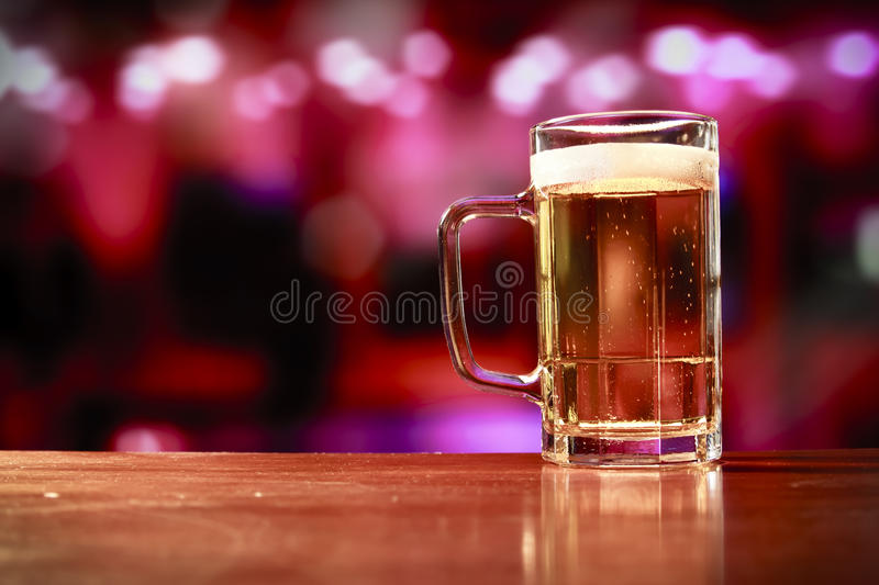 Delicious beer mug on a bar. Beer mug on a bar stock images