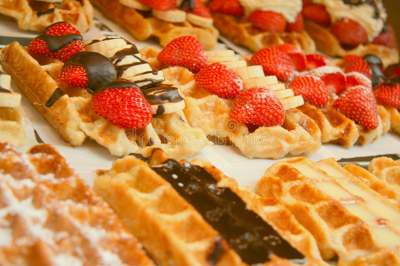 Delicious belgian waffles. Sweet and delicious belgian waffles royalty free stock photos