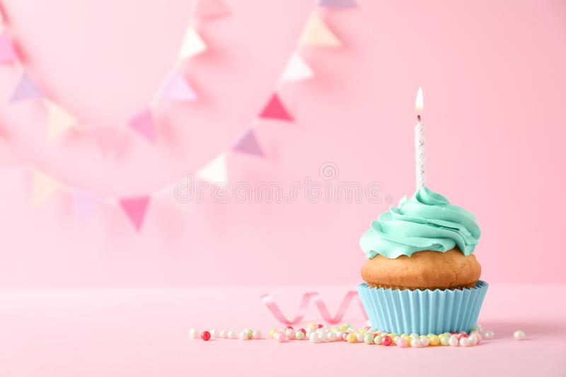 Delicious birthday cupcake with candle. And space for text on color background royalty free stock photography