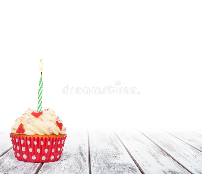 Delicious birthday cupcake on table royalty free stock images