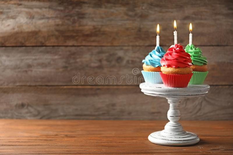 Delicious birthday cupcakes with candles. On table royalty free stock images
