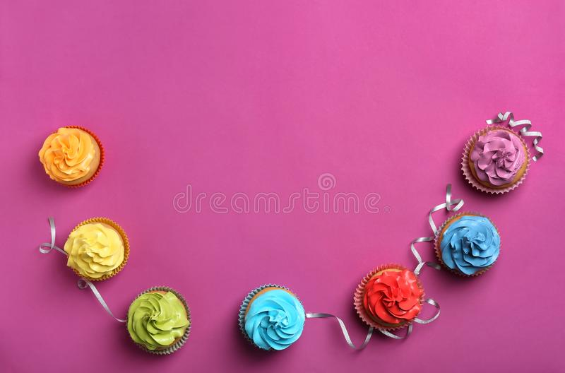 Delicious birthday cupcakes. On color background stock images