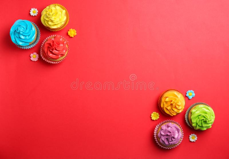 Delicious birthday cupcakes. On color background stock photos