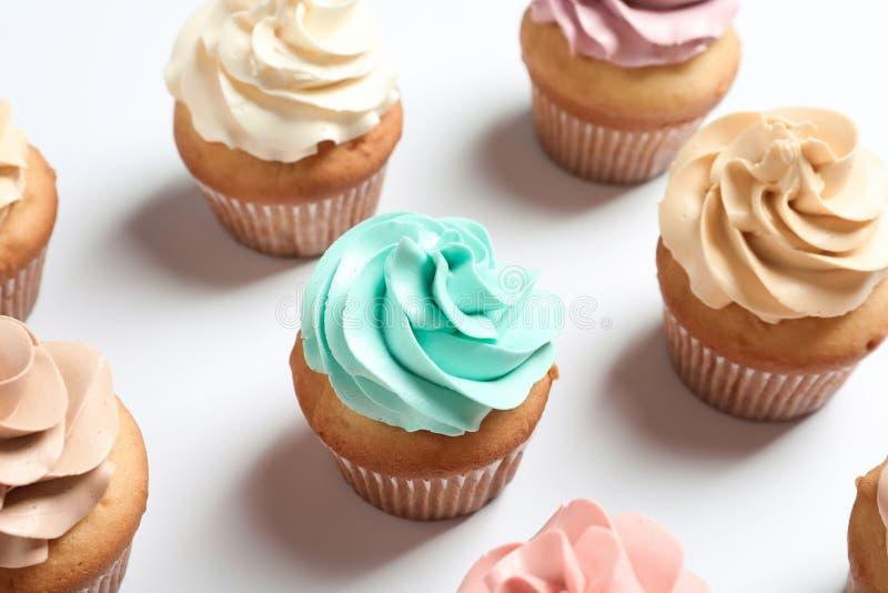 Delicious birthday cupcakes. On white background, closeup royalty free stock photo