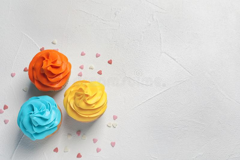Delicious birthday cupcakes. On light background royalty free stock image