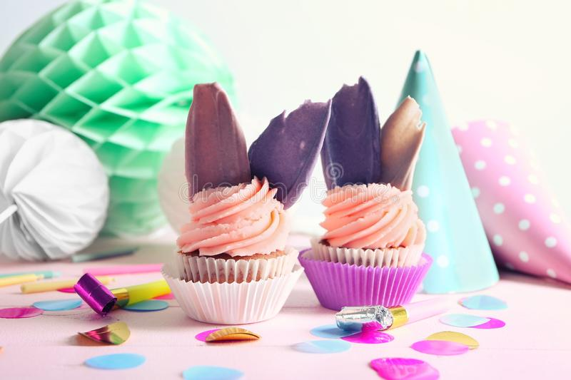 Delicious birthday cupcakes on table royalty free stock image