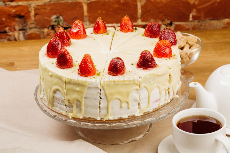 Delicious biscuit cake with fresh strawberries and biscuit cream royalty free stock photos