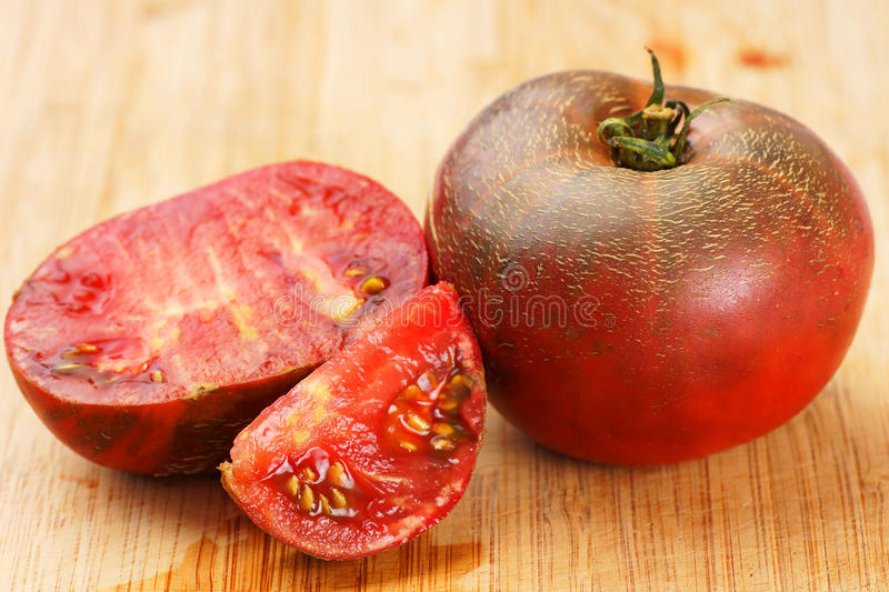 Download Delicious black tomatoes stock image. Image of piece - 33512613