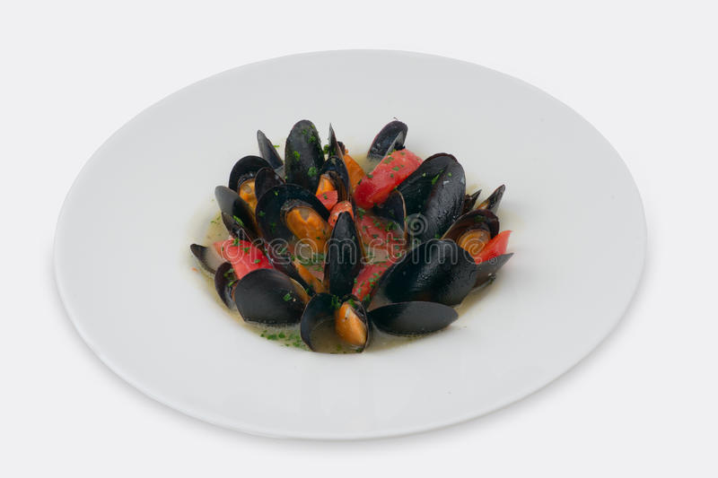 Delicious blue cooked mussels. Isolated on white studio background royalty free stock photo