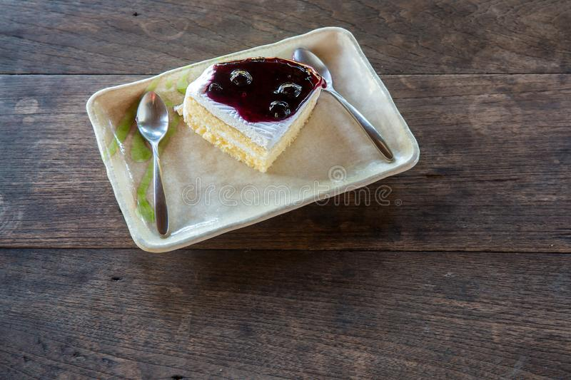 Delicious blueberry cheesecake. Blue berry cake slices on wood plate. royalty free stock images