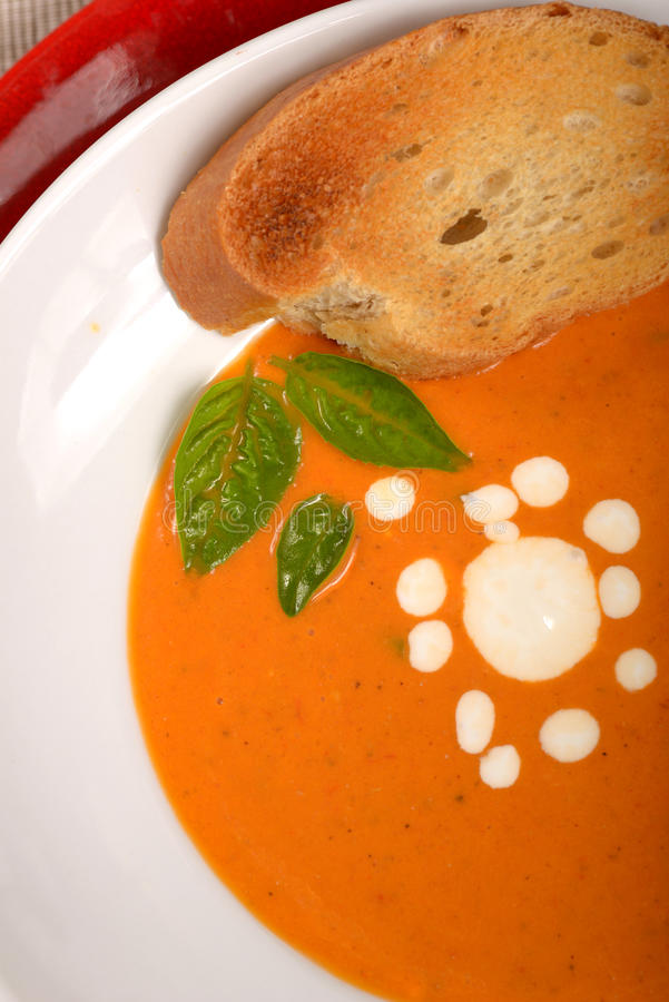 Free Delicious Bowl Of Tomato Soup With Grilled Bread And Basil Royalty Free Stock Photography - 34070407