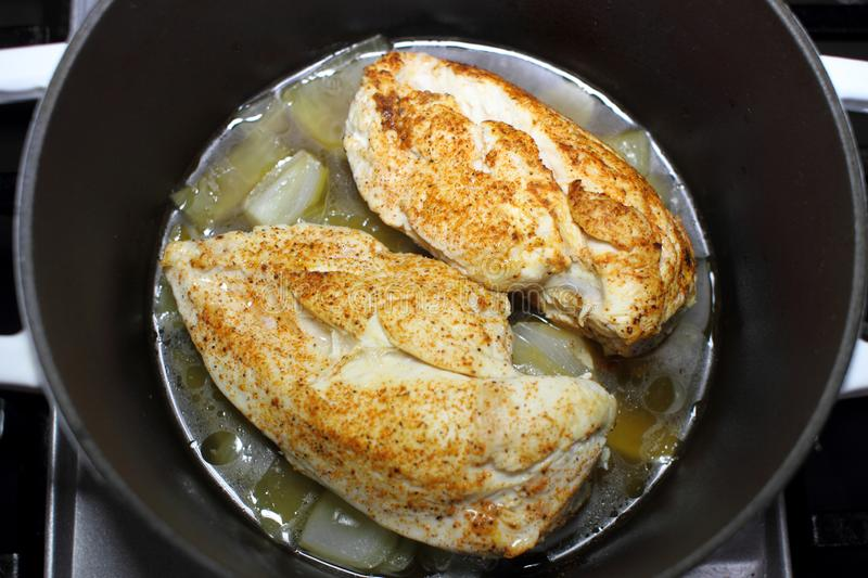 Delicious braised chicken breast cooked in a Dutch oven royalty free stock photo