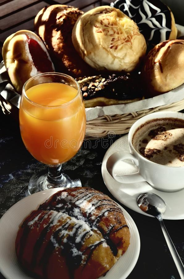 Delicious Bread, Hot coffee and orange juice royalty free stock images