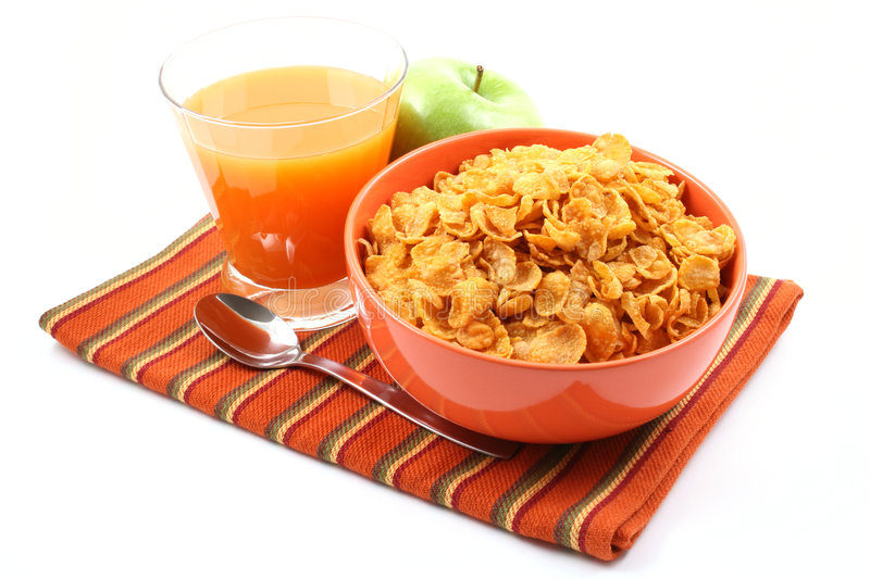Delicious breakfast. Cereals green apple and juice isolated on white stock image