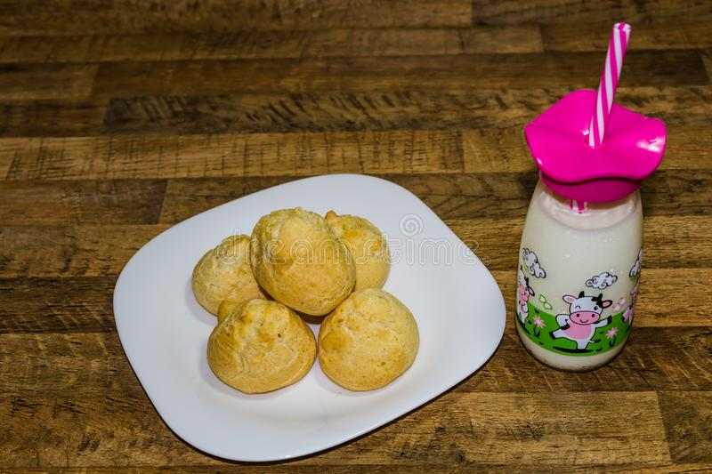 Delicious breakfast, cheese bread served with milk, traditional food of the State of Minas Gerais, Brazil.  stock images