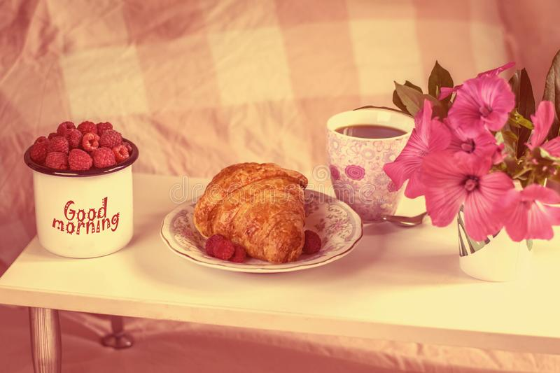 Delicious Breakfast; coffee and croissant with raspberry, flowers. Breakfast in bed. Retro. Delicious Breakfast; coffee and croissant with raspberry, flowers royalty free stock photo