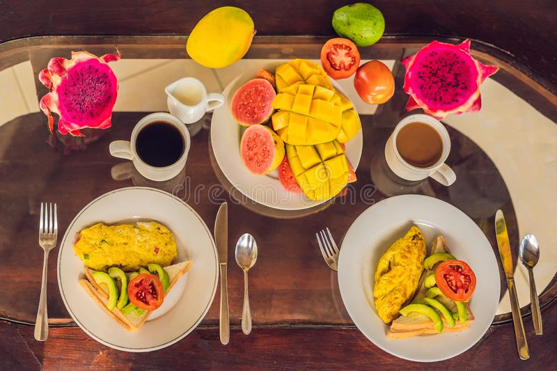 A delicious breakfast consisting of omelet, fruit and coffee.  stock image