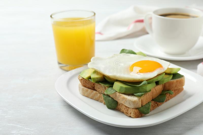 Delicious breakfast with fried egg  on table. Delicious breakfast with fried egg served on table royalty free stock photography