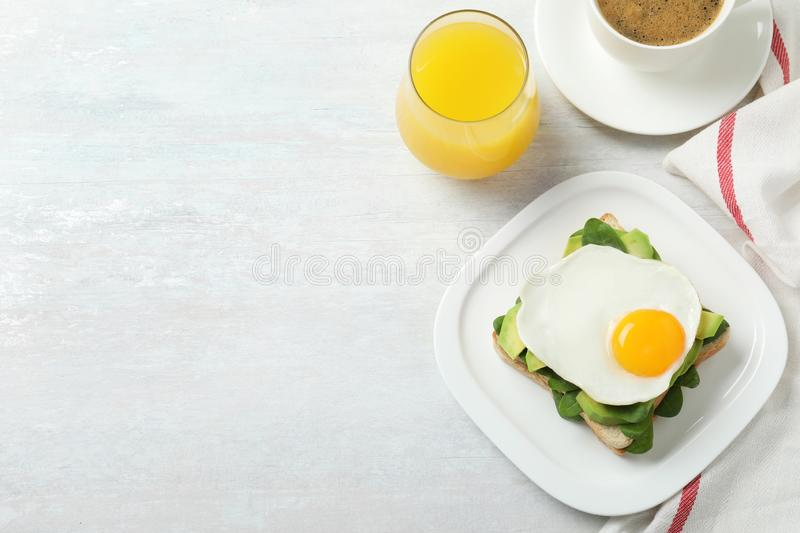 Delicious breakfast with fried egg served on table, flat lay. Space for text royalty free stock photo