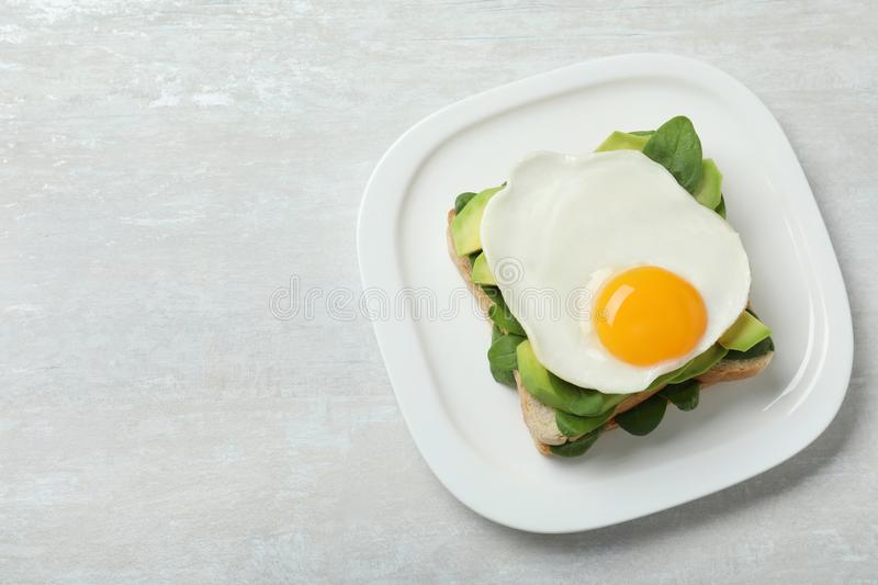Delicious breakfast with fried egg served on table. Space for text. Delicious breakfast with fried egg served on table, top view. Space for text royalty free stock photography