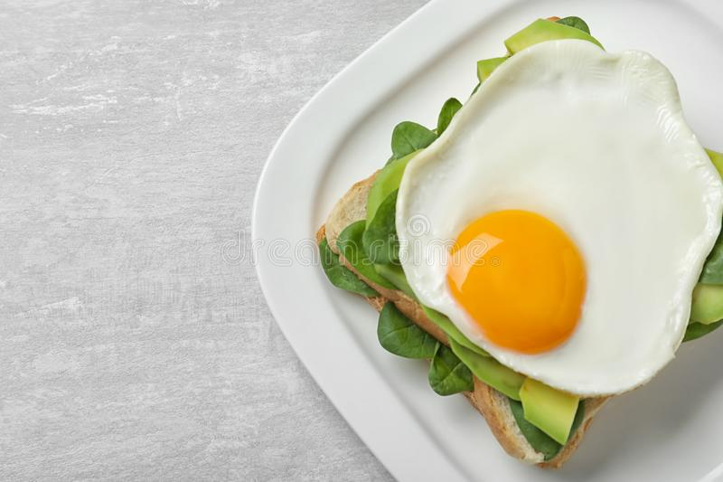 Delicious breakfast with fried egg served on table. Space for text. Delicious breakfast with fried egg served on table, top view. Space for text royalty free stock photo