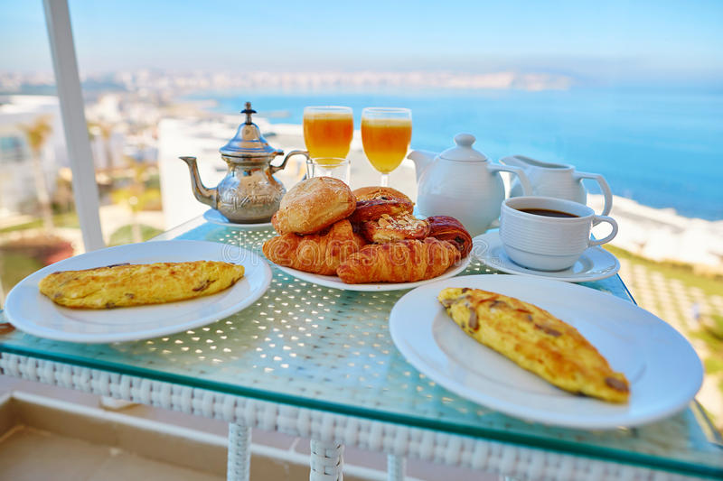 Delicious breakfast with sea view stock images