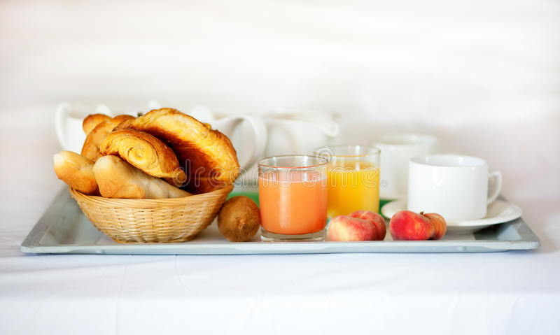 Delicious breakfast served in bed royalty free stock photography