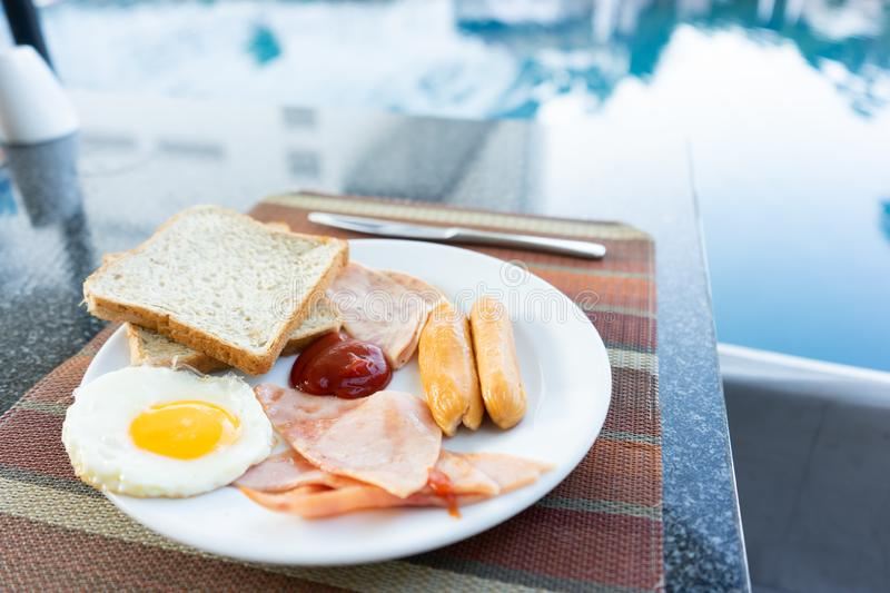 Delicious Breakfast set by the swimming pool at Pattaya, Thailand. With copy space background royalty free stock photo