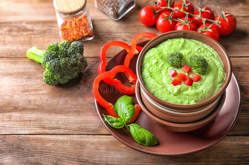 Delicious broccoli soup with bell pepper in bowl stock photo