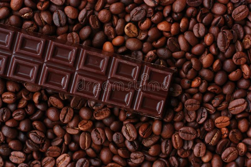 Delicious brown chocolate and coffee beans close up stock image